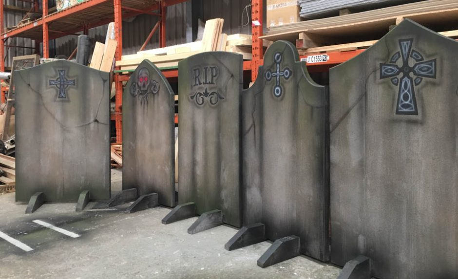 Getting a row of grave stones ready